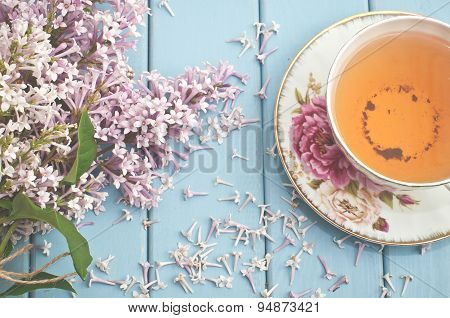 Summer Blooming Bouquet And A Cup Of Black Tea