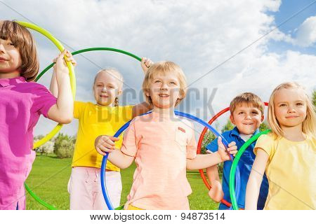 Close-up of children holding hula hoops in park