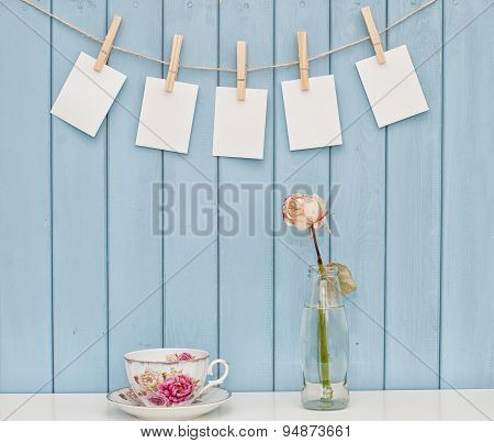Photos Hanging On Rope With Clothespins