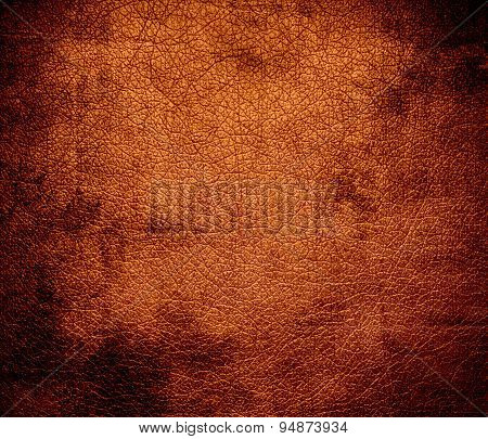 Grunge background of alloy orange leather texture