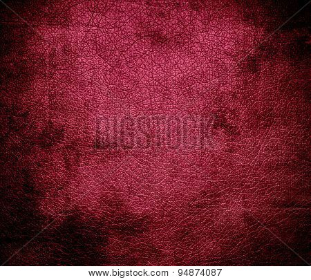 Grunge background of amaranth deep purple leather texture