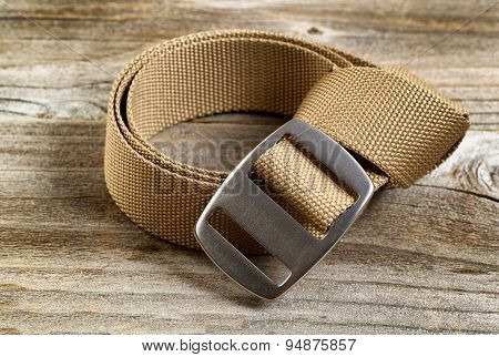 Utility Nylon Belt With Buckle On Rustic Wooden Boards