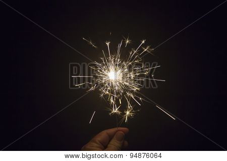 Sparkler In Hand During Night Time Celebration