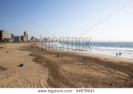 People On Beach Against City Skyline In Durban