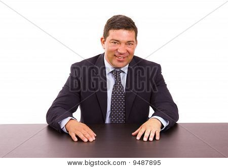 Mature Business Man On A Desk