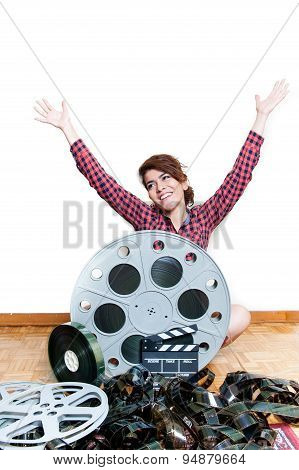 Young Smiling Woman With Cinema Movie Reels Arms Up