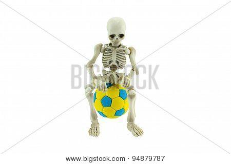 Skeleton Sit On Soccer Ball Isolated On White Debt Of Football Concept.