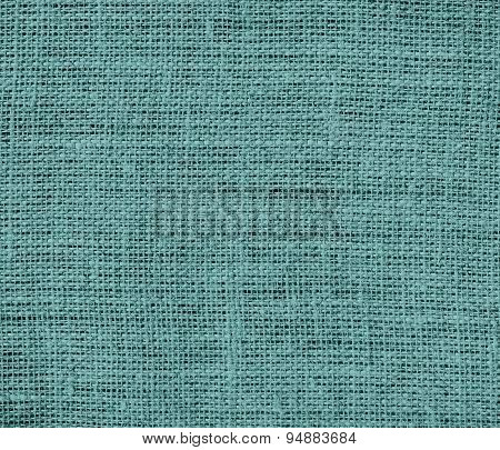 Desaturated cyan burlap texture background