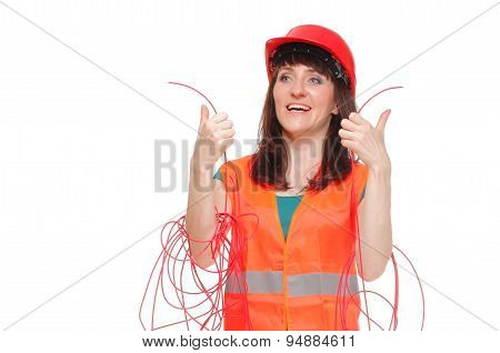 Builder Woman In Reflective Vest And Entangled Red Cable