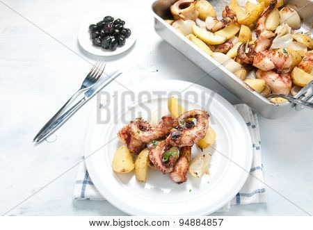 Octopus alla lagareiro a typical Portuguese dish with potatoes and onions