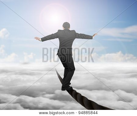 Businessman Balancing On A Wire With Sky Sub Cloudscape