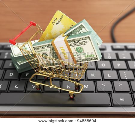 Us Hundred Dollar Bills And Shopping Cart With Credit Card On The Modern Computer Keyboard. Dollars