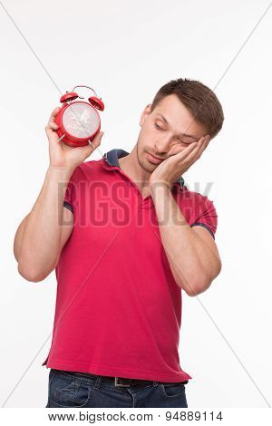 Young man with alarm clock