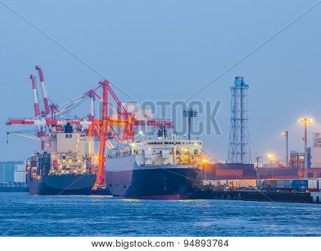 Cargo freight ship with container at harbor terminal