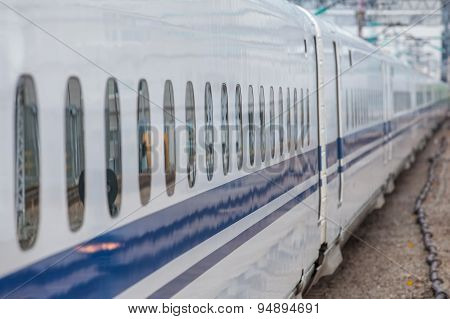 Close - up High speed train window at railway station