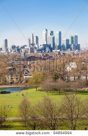 LONDON, UK - APRIL 14, 2015: Canary Wharf view from the Greenwich hill. Modern skyscrapers of bankin