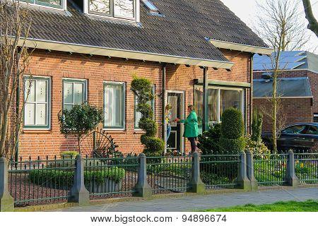 Two Women Chatting On The Doorstep In The Dutch Town Of Meerkerk, Netherlands