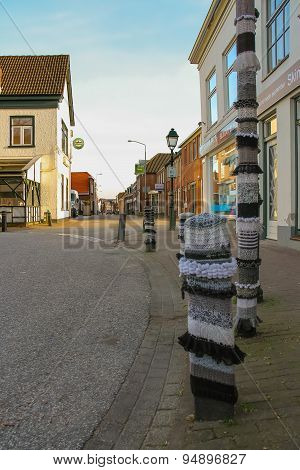 Roadside Pillars Decorated With Knitted Clothes In The Dutch Town Meerkerk, Netherlands