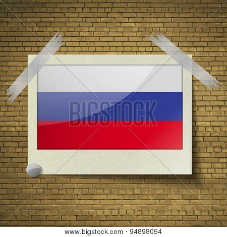 Flags Russiaat Frame On A Brick Background. Vector