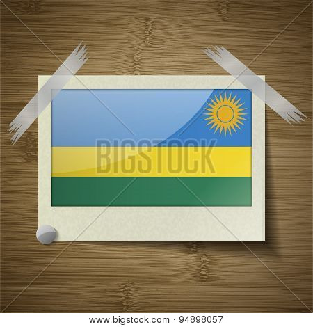 Flags Rwanda At Frame On Wooden Texture. Vector