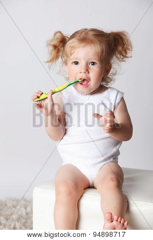 Sweet Little Child Brushing Her Teeth