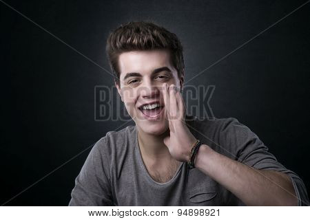 Attractive Young Man Shouting Out Loud