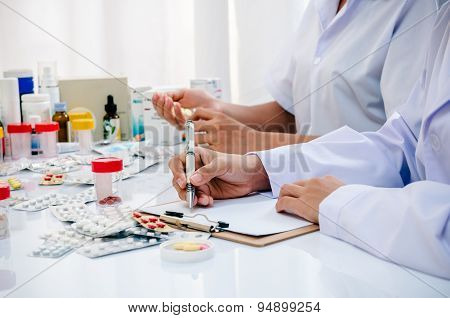 pharmacists working in office