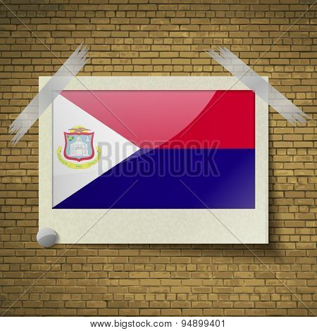 Flags Saint Martinat Frame On A Brick Background. Vector