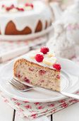 stock photo of banana  - A Piece of Banana Cake with Sugar Glaze Topped with Raspberries and Banana Slices copy space for your text shallow dof  - JPG