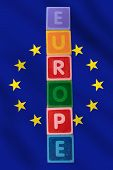 Europe And Flag In Toy Block Letters poster