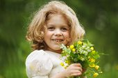 pic of girlie  - Happy girl with a bouquet of yellow flowers - JPG