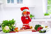 picture of vegetarian meal  - Kids cooking fresh vegetable salad in white kitchen - JPG