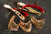 foto of leek  - Lamb chops cooked on the grill with leek and red pepper - JPG