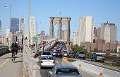 pic of brooklyn bridge  - cyclist beating a rush hour traffic jam over the brooklyn bridge - JPG