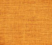 foto of saffron  - Deep saffron burlap texture or background for design - JPG