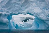 foto of hollow log  - Large Arctic iceberg with a cavity inside - JPG