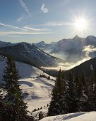pic of snow capped mountains  - sun setting over snow - JPG