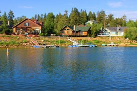 image of dock a lake  - Modern lakefront homes with its own docks and boats amongst a pine forest  taken in Big Bear Lake - JPG