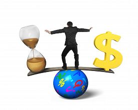 stock photo of seesaw  - Man standing between hourglass and golden dollar sign balancing on seesaw of wood board and colorful ball isolated on white - JPG