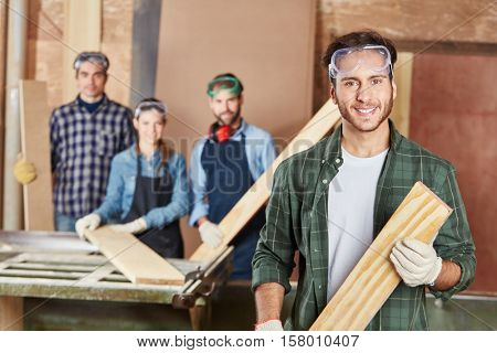 Man as carpenter with wood on his hands