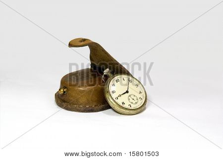 Antique pocket watch with leather case isolated on white background.
