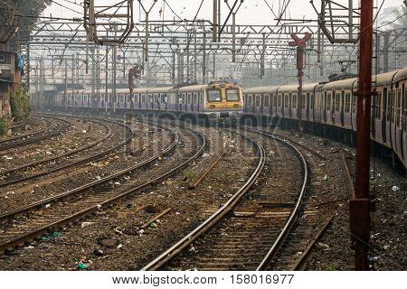 Mumbai, India - February 29, 2016: The local train running on one of the many railroads in Mumbai (Bombay), India.