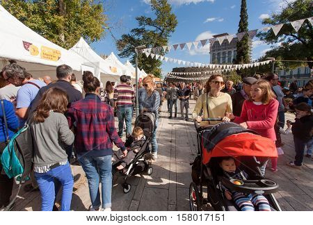 TELAVI, GEORGIA - SEP 30, 2016: Mothers with baby carriages stroll through the bustling city street during festival TelaVino on 30 September, 2016. Telavi of Kakhetia has population 22000