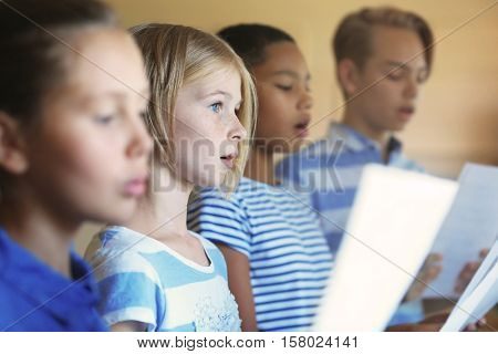 Schoolchildren singing song on music lesson