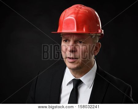 Businessman Wearing Construction Helmet