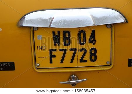 KOLKATA, INDIA - FEBRUARY 10: West Bengal license plate on a Ambassador car which are used as taxsi on the streets of Kolkata, India on February 10, 2016.