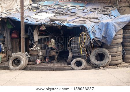 KOLKATA, INDIA - FEBRUARY 10: A tire replacement service. A vast number of vehicles in India are serviced by such local enterprises. Kolkata, India on February 10, 2016.
