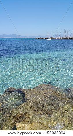 Beautiful sea views with yacht and Palma de Mallorca on the horizon Majorca Balearic Islands Spain