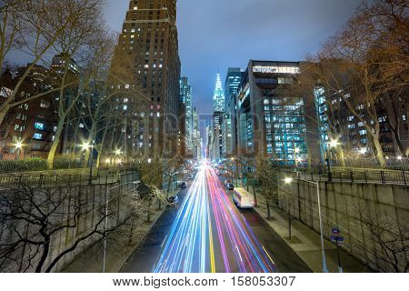 Night cars traffic in big city, long exposure. 42nd street, New York City, USA