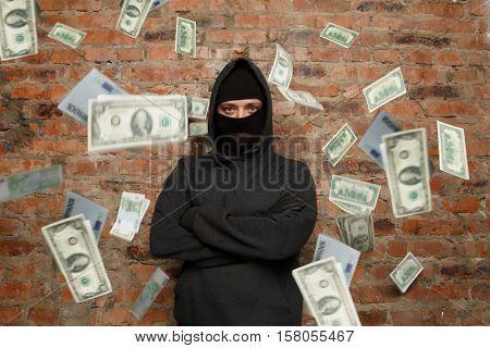 Serious thief near brick wall